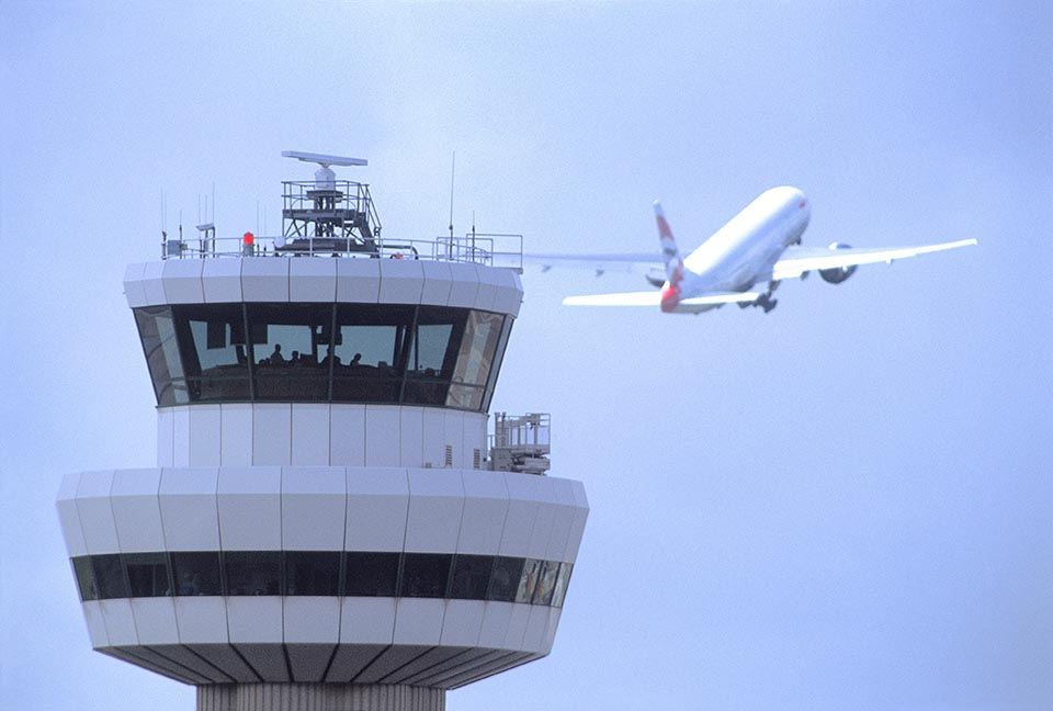 Gatwick Airport, Control tower with aircraft in flight in background
